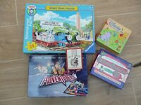 Various Puzzles and games plus balloon modelling kit.