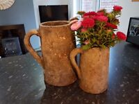 Two jugs suitable for flowers or kitchen utensils