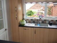 Fully fitted kitchen including integrated appliances.