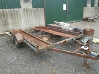 Car transporter trailer with twin axel and overbraking