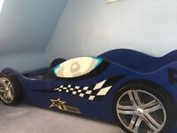 Blue racing car bed