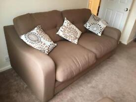 Brown sofa with matching armchair and pouffe