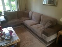Taupe corner sofa with matching footstool - very comfortable and excellent condition
