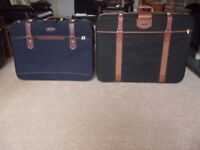 Two Suitcases with pull handles and wheels