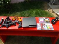 PS3 with SingStar, Lightgun, PS Move and over 60 games