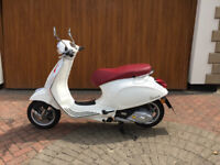 2016 Piaggio Vespa Primavera 125 ABS in white with red seat