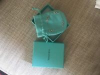 Unwanted gift. Tiffany silver infinity bracelet with receipt and gift box