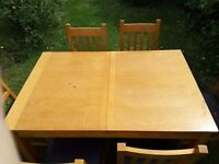 Extending Wooden Dining table and six chairs