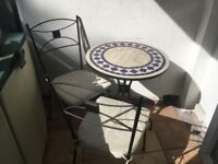 Wrought-iron, mosiac table-and-two-chairs set for a balcony / patio / garden