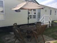 Hardwood garden table and four chairs with parasol