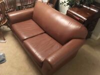 Brown cowshide leather sofabed, in excellent condition, bought from Next, with sprung interior.