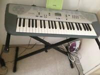 Casio keyboard with stand and book very good condition