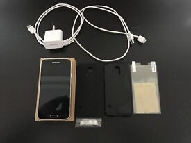 Samsung Galaxy S5 Black 16GB + Charger + 2 cases + screen protector + 3 extra charge cables UNLOCKED