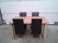 New set extend dining table and four chairs. Choc and oak colours. Can deliver, Bargain.