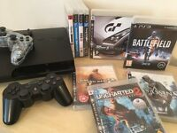 MASSIVE BUNDLE - PS3 Slim Console 320GB + 2 Controllers + 9 Huge Games inc Uncharted 2 COD 2 & More