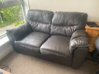 2 faux leather sofas , slightly worn