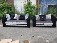 Lovely black and silver crushed velvet sofa suite. 3 and 2 seaters. 1 month old.can deliver