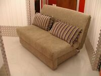 Two seater Deamworks Bed fold down settee. Lovely condition & very comfortable. 2 scatter cushions