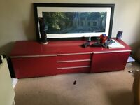 Glossy red living room console / tv