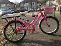 Pink bicycle for kids 4-9 years. Adjustable with basket and additional rear seat.