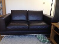 2 seater black leather sofa in excellent condition £100 ono