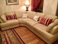 Leather corner sofa , cream, ivory, neutral color.