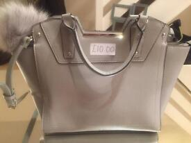 Grey bag with fluffy zip