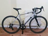 B TWIN Triban 100 road and off road bike in excellent condition