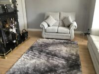 Three seater and two seater cloth sofas