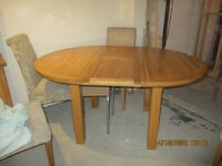 Oak Furnitureland solid oak dining table and bureau