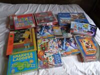 Jigsaw puzzles, mostly new and sealed. All ages