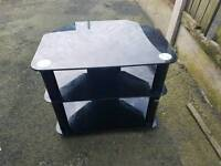 2 x Black glass TV stands