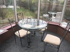 Wrought iron & glass dinning table with 4 chairs