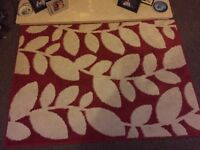 Medium size red floral rug, open to offers