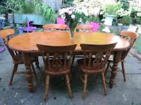 Large solid wood farmhouse dining table and 6 chairs