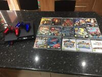 PS3 with 2 control pads, 15 games, 2 portals and 16 figures