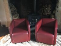 Two Red Leather Designer Chairs