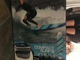 SWAPor SALE: NEW inflatable surf board for a paddle board