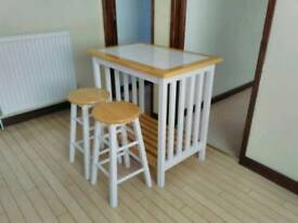 Wooden breakfast table and stools