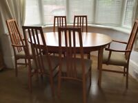 Extendable dining table with chairs and matching display cabinet