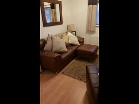Brown leather sofa and foot stool great condition
