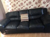 Three seater wide leather sofa