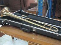 A cased trombone marked - Dearman - Sole Distributors - Dallas - London - foreign