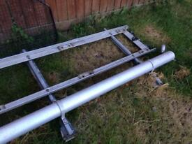 Roof rack and cage for behind seats