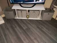 white tv stand with boxes