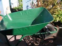 green wheel barrow