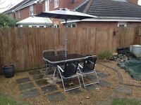 Garden Table, Chairs and Swing.