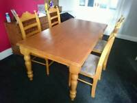 Large solid pine table and 4 chairs