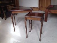 Two mahogany colour nesting tables