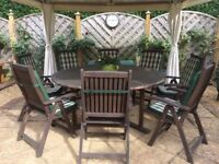 solid hardwood, round table & 8 carver chairs.